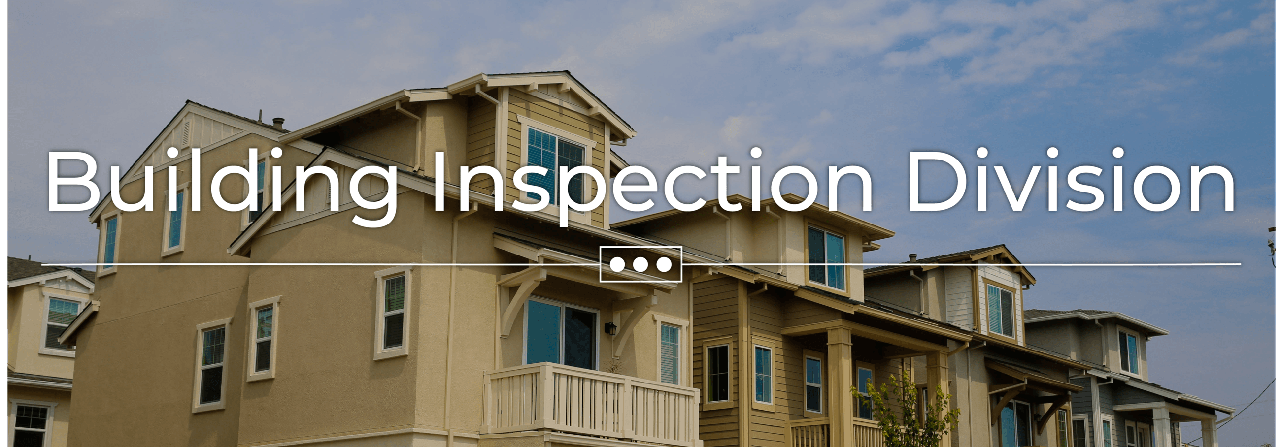 """Building Inspection Division"" text is on top of an image of homes"