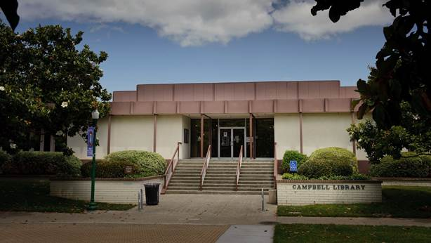 The front entrance of the Campbell Library during the day.